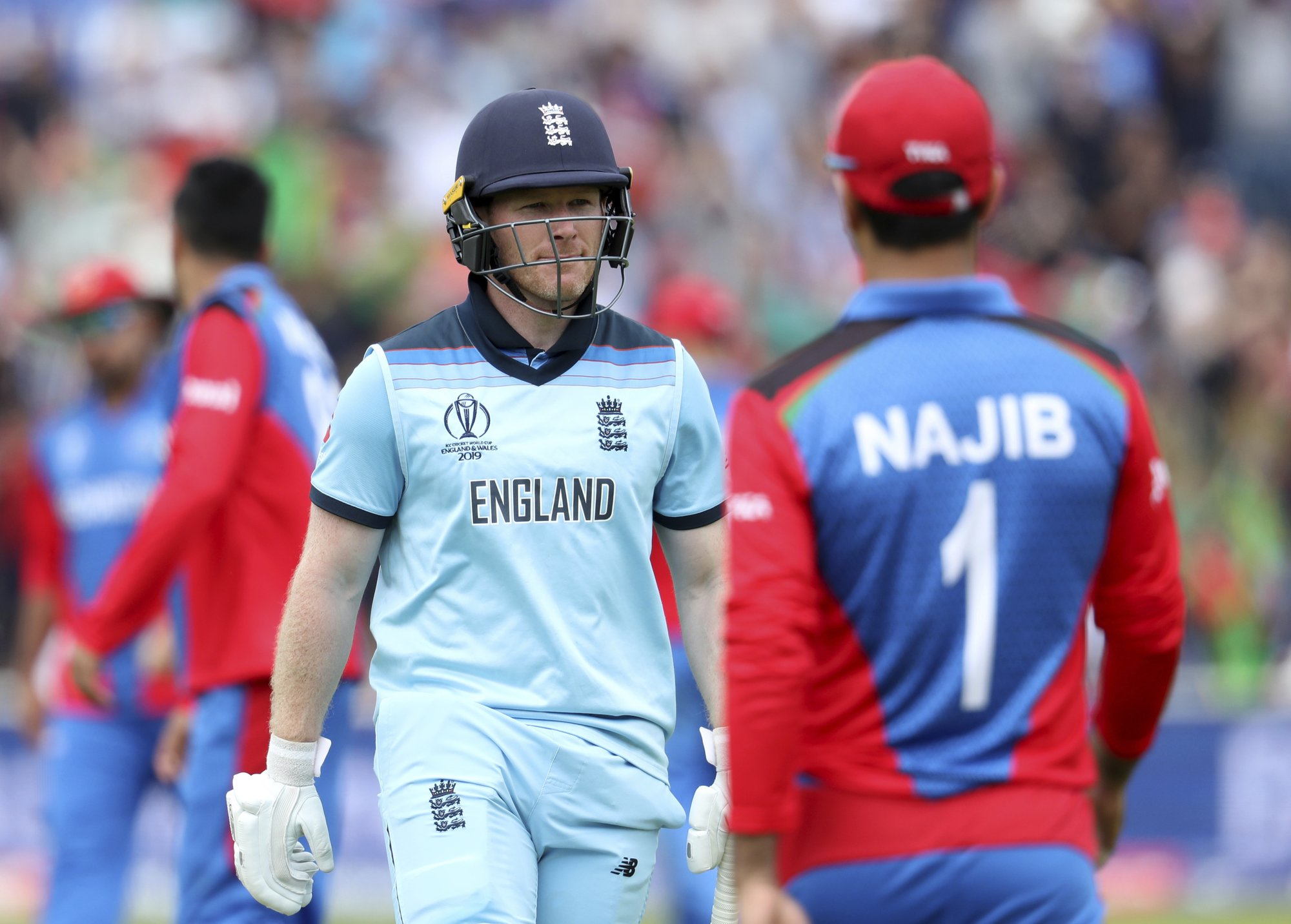 The Latest: Morgan, England set records in World Cup win