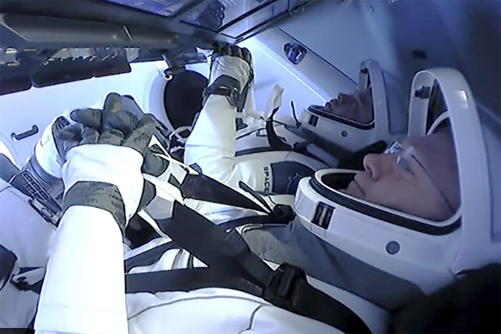 SpaceX capsule with NASA astronauts streaking toward Earth