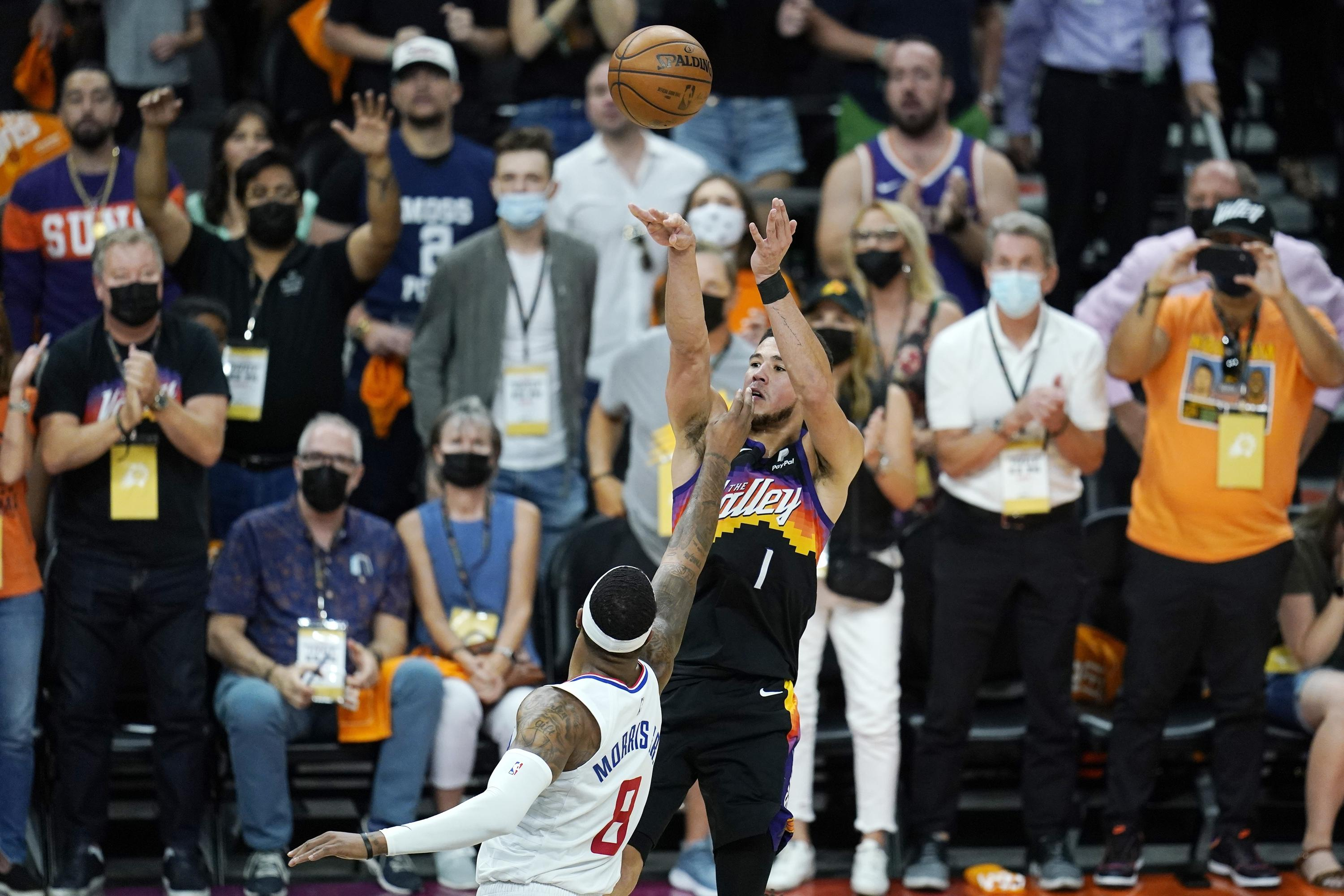 Booker gets first triple-double, Suns beat Clippers 120-114