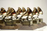 FILE - In this Oct. 10, 2017, file photo, various Grammy Awards are displayed at the Grammy Museum Experience at Prudential Center in Newark, N.J. The Grammys is sticking to its word with the public release of the full inclusion rider to ensure equity and inclusion on all levels of production for next year's ceremony. The Recording Academy released on Tuesday, Oct. 19, 2021, an eight-page document detailing the rider's purposes and objectives. The agreement will require producers to recruit and hire more diverse candidates backstage and in front of the camera for the 64th annual awards ceremony on Jan. 31.  (AP Photo/Julio Cortez, File)