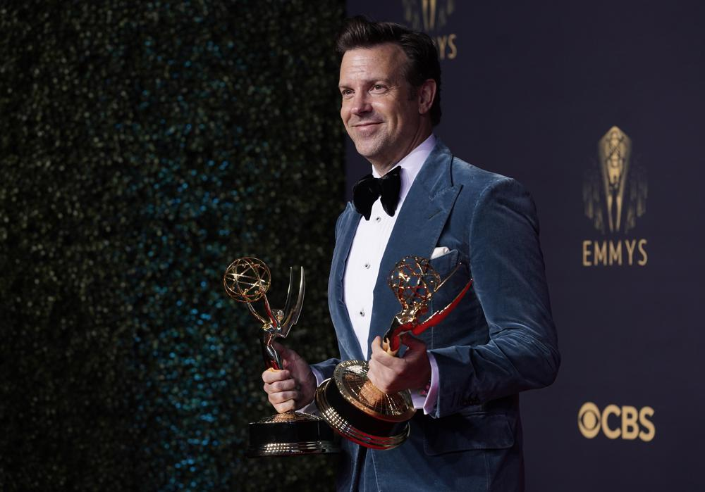 """Jason Sudeikis poses for a photo with the award for outstanding lead actor in a comedy series for """"Ted Lasso"""" at the 73rd Primetime Emmy Awards on Sunday, Sept. 19, 2021, at L.A. Live in Los Angeles. (AP Photo/Chris Pizzello)"""