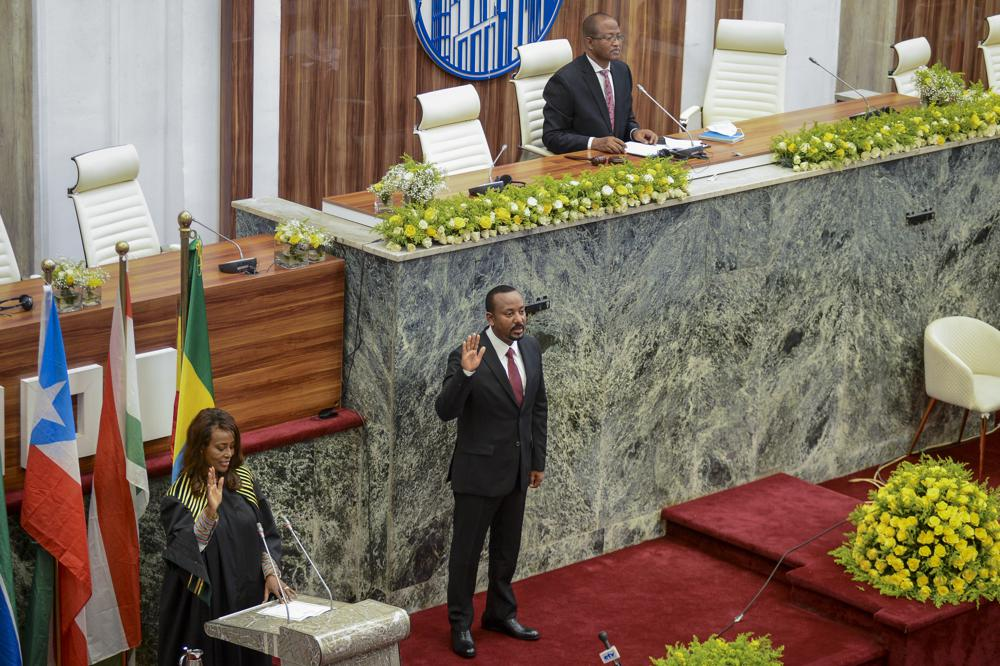 Ethiopia's Prime Minister Abiy Ahmed is sworn in for a second five-year term, at the House of Peoples Representatives in the capital Addis Ababa, Ethiopia Monday, Oct. 4, 2021. The prime minister, the 2019 Nobel Peace Prize winner for restoring ties with neighboring Eritrea and for pursuing sweeping political reforms, now faces major challenges as war in the Tigray region spreads into other parts of the country. (AP Photo)