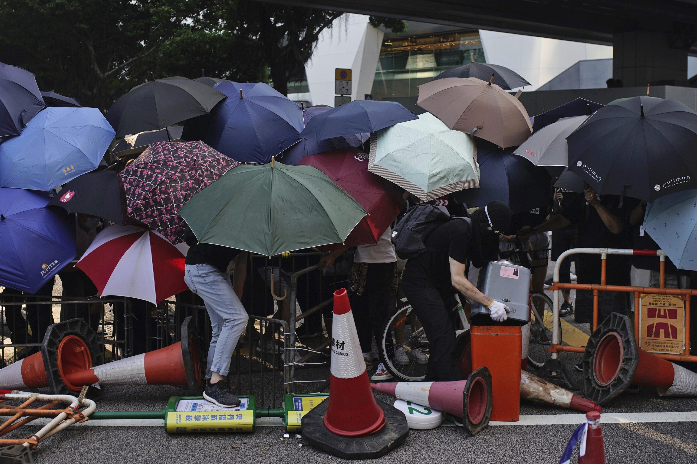 Thousands protest mask ban as HK leader toughens stance