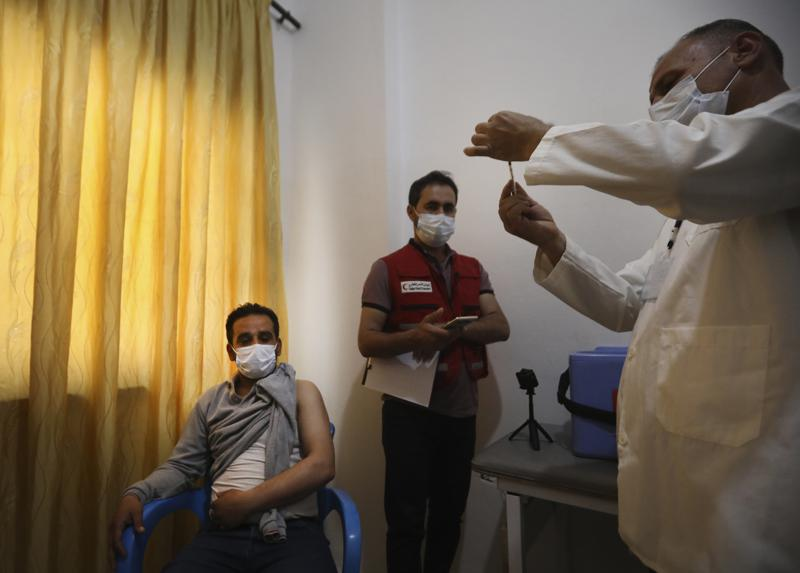 COVID-19 vaccine campaign begins in Idlib city amid virus surge in rebel-held Syria