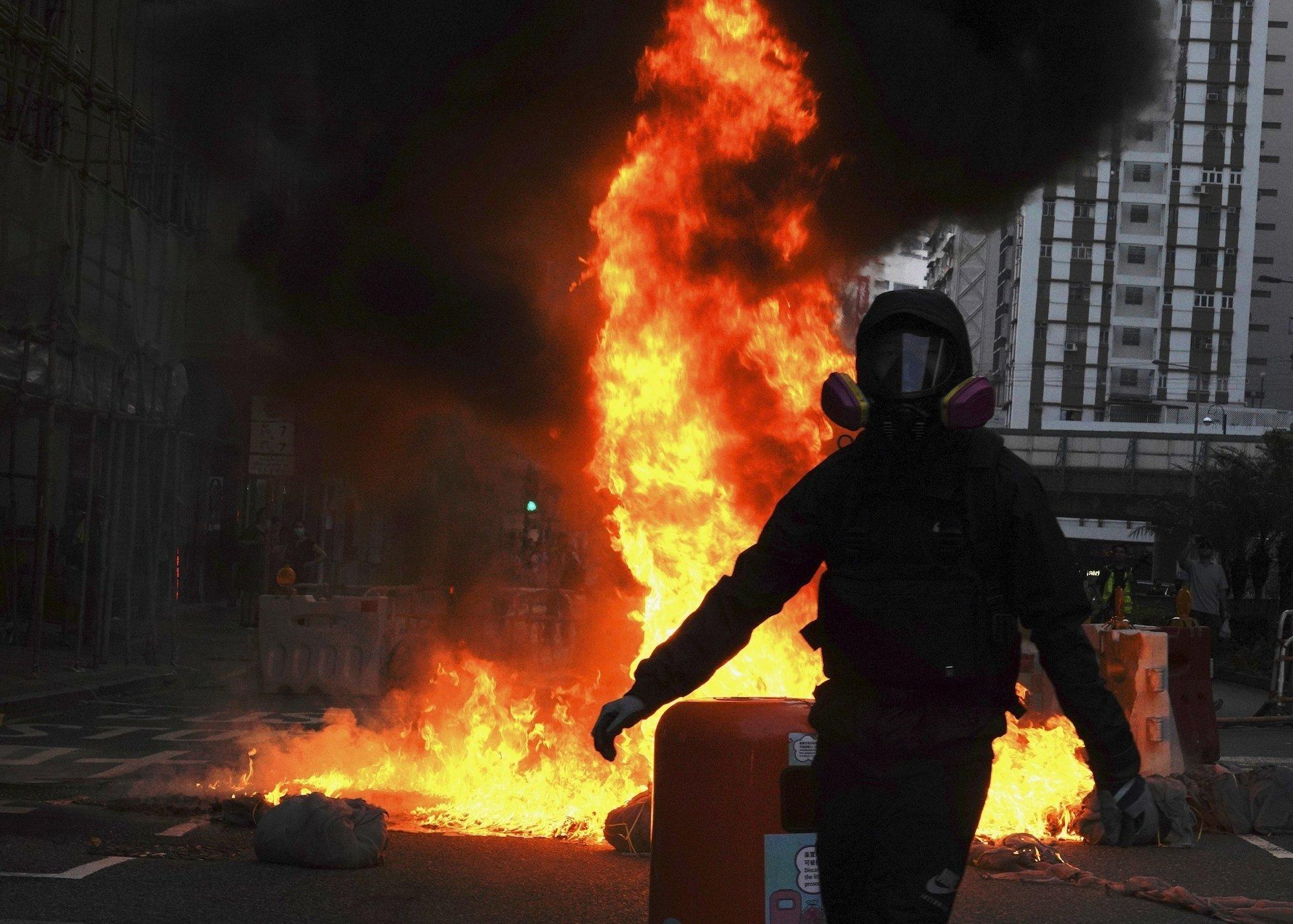 Hong Kong descends into chaos again as protesters defy ban