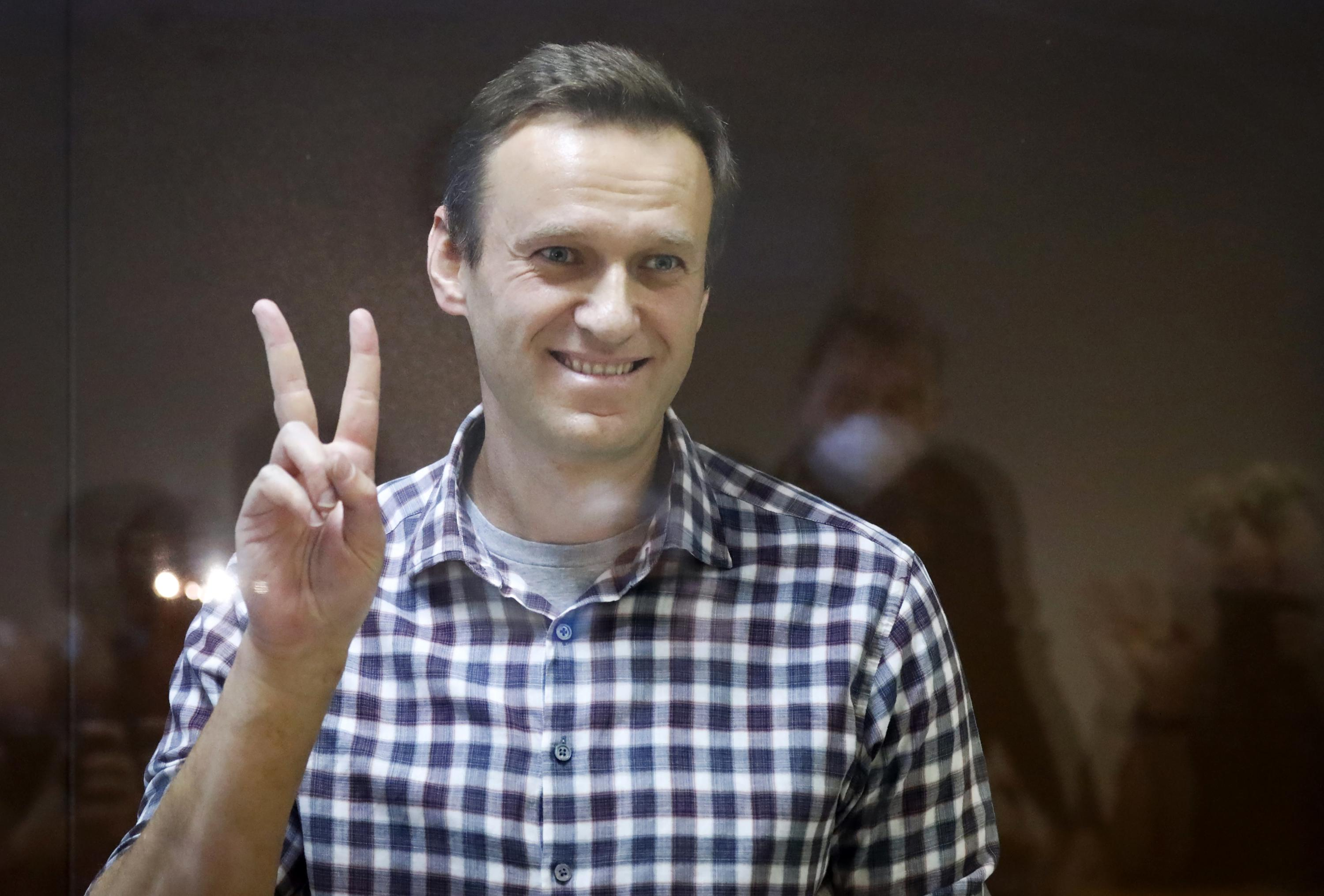 Russia urges Apple, Google to remove Navalny app from stores - Associated Press
