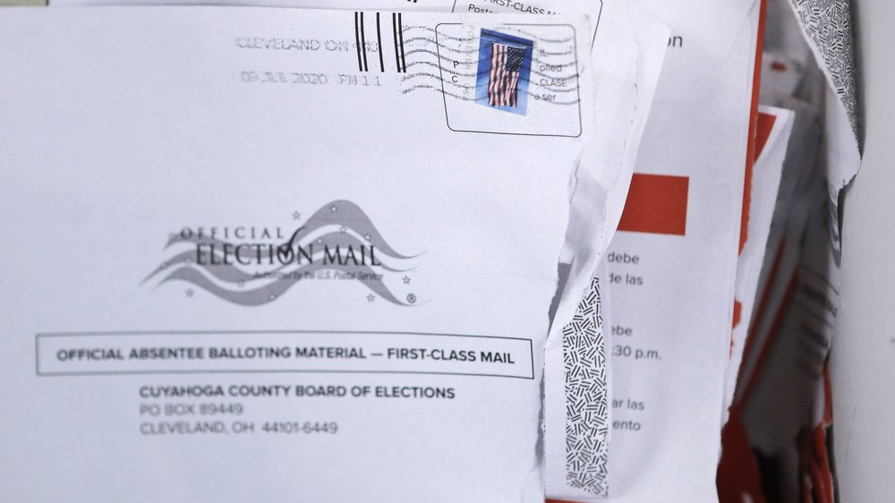As more states embrace mail-in voting, questions about postage is emerging