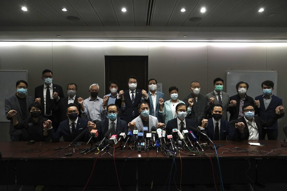 Hong Kong's pro-democracy lawmakers announce decision to resign en masse