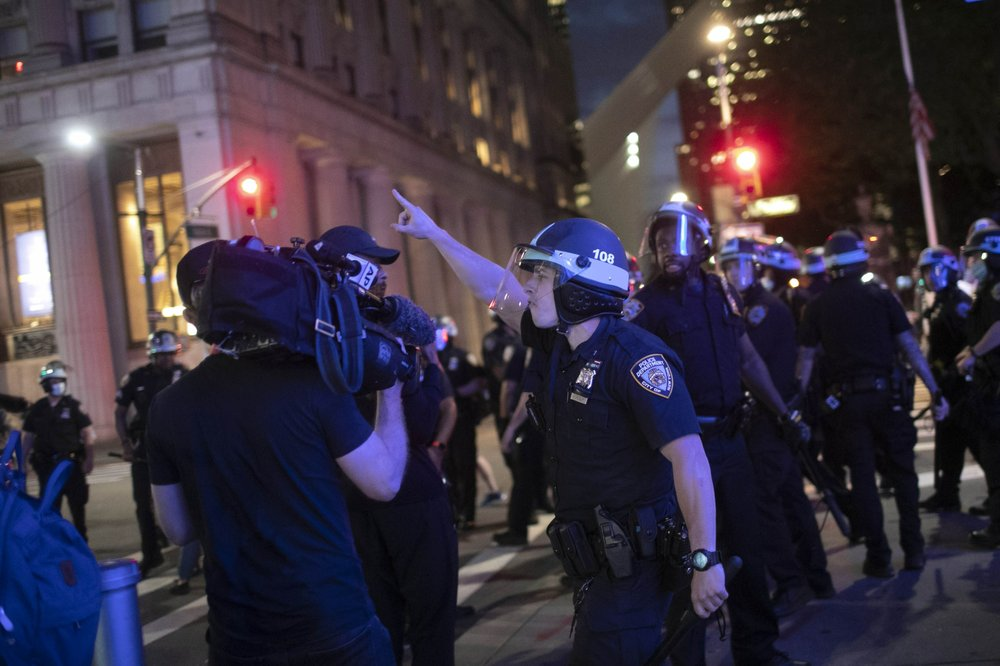 Videojournalist Robert Bumsted and photographer Maye-E Wong working together to document the protests in lower Manhattan over the killing of George Floyd in Minneapolis were shoved and ordered by police to leave the area
