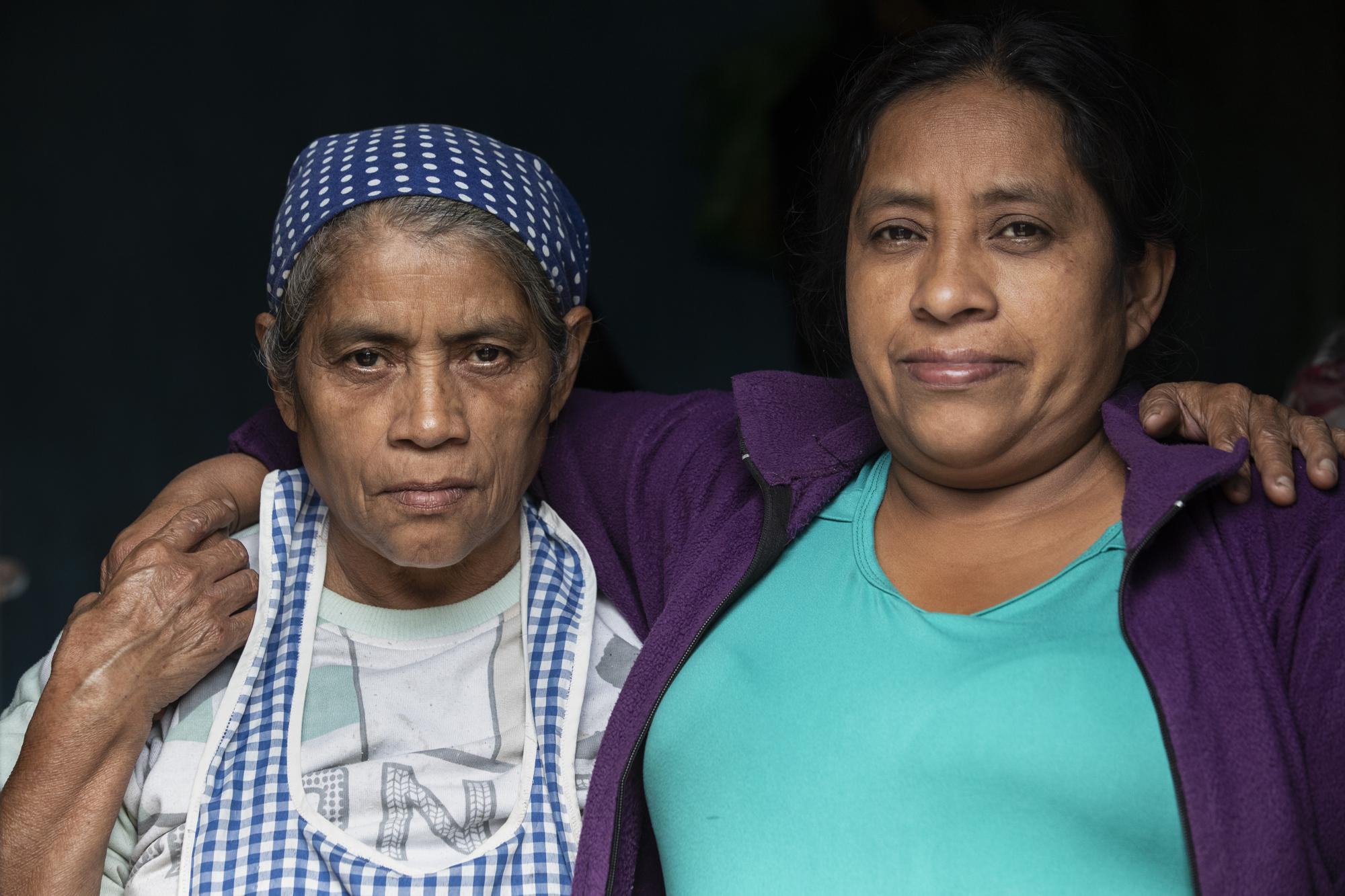 Alvina Jeronimo Perez, right, poses for a portrait with her mother Felipa de Jesus Perez at he mother's home in Tizamarte, Wednesday, Dec. 9, 2020. Felipa, 65, explained that their land has been passed down through the family since her grandparents, tenant farmers who had cultivated the land and eventually were given small parcels to live on. (AP Photo/Moises Castillo)