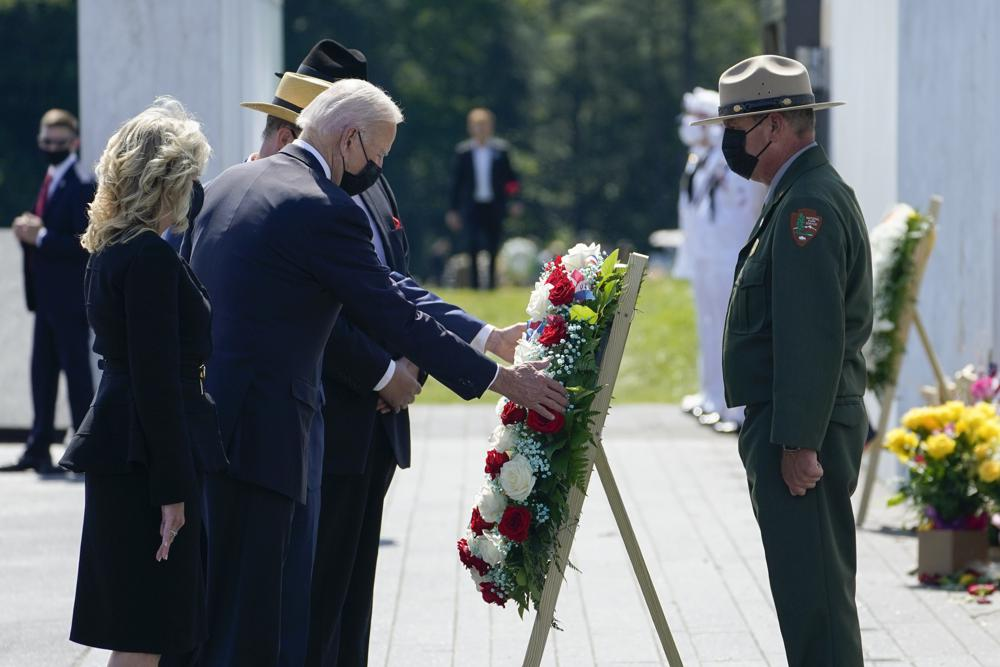 President Joe Biden and first lady Jill Biden lay a wreath at the Wall of Names during a visit to the Flight 93 National Memorial in Shanksville, Pa., Saturday, Sept. 11, 2021. The Bidens visited to commemorate the 20th anniversary of the Sept. 11, 2001, terrorist attacks. National Park Service park ranger Robert Franz stands at right. (AP Photo/Evan Vucci)