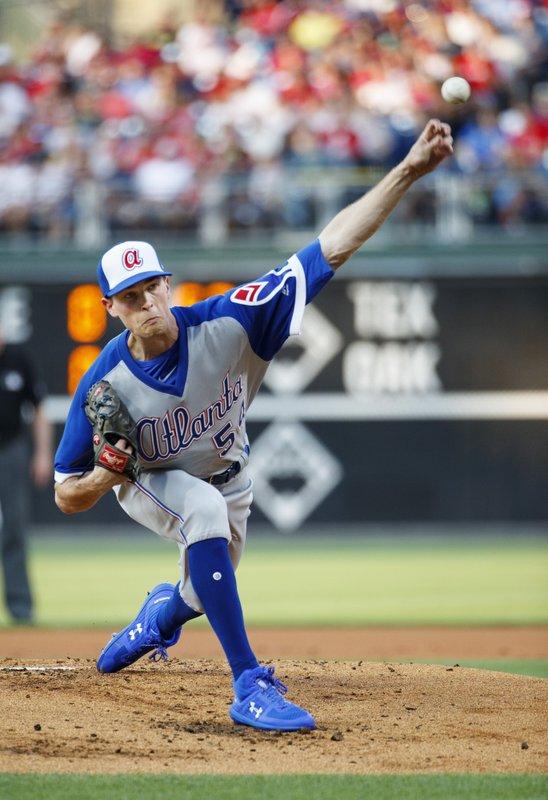 wholesale dealer 8069a 4f4d5 Albies hits slam, Braves rout burgundy-clad Phillies 15-7