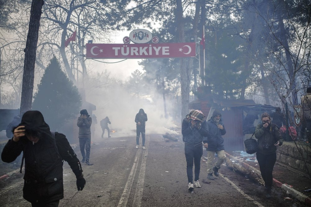 Turkey opens gates into Europe as migrants gather on border