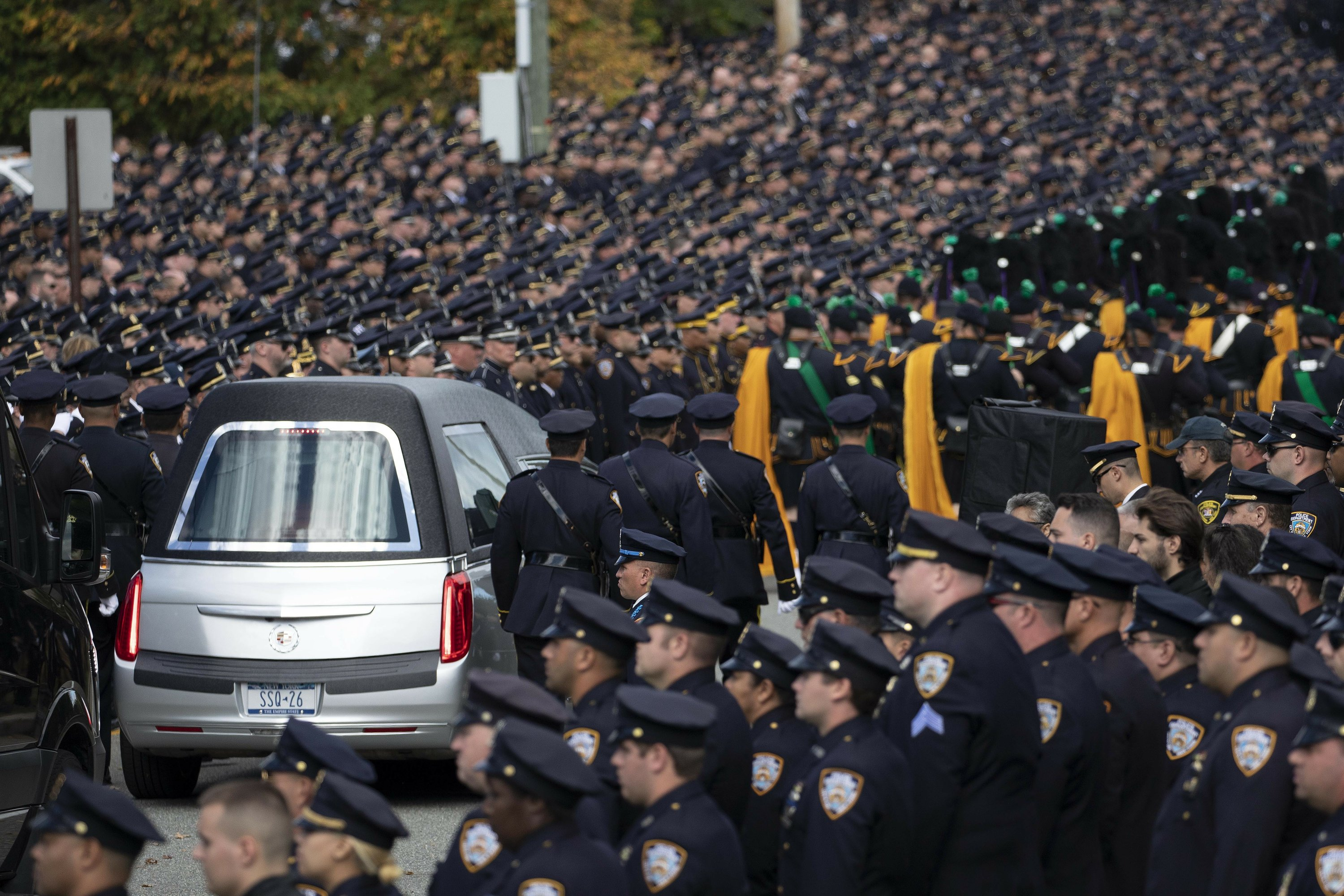 NYPD officer killed by friendly fire is hailed as a hero