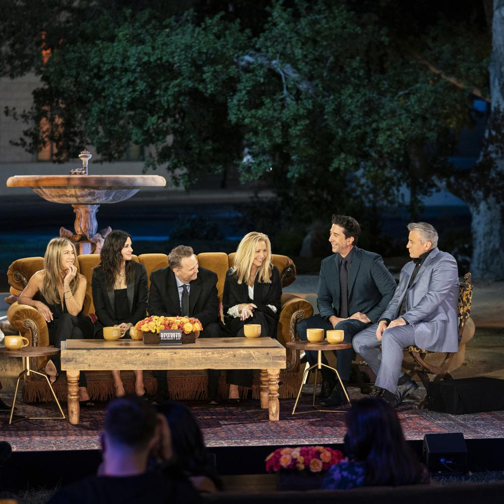 """This image provided by HBO Max shows Jennifer Aniston, from left, Courteney Cox, Matthew Perry, Lisa Kudrow, David Schwimmer and Matt LeBlanc in a scene from the """"Friends"""" reunion special. (Terence Patrick/HBO Max via AP)"""