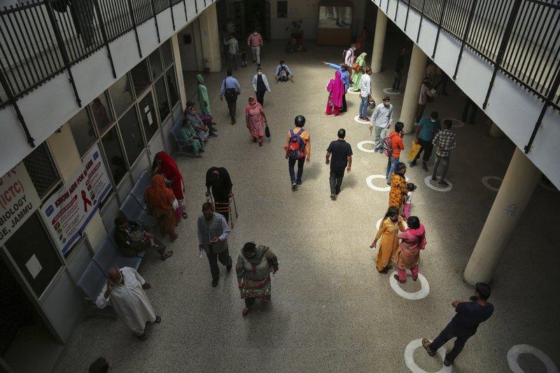 India's capital to lock down amid devastating virus surge