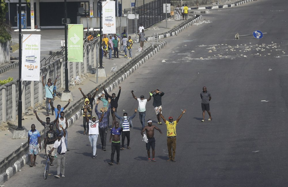 Nigeria protesters demanding an end to police brutality break curfew amid gunfire; draws global outrage