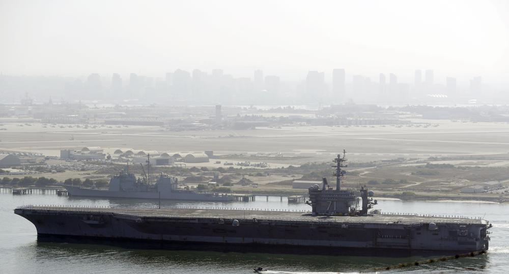 USS Theodore Roosevelt Navy carrier sidelined by virus returns home to San Diego with new captain