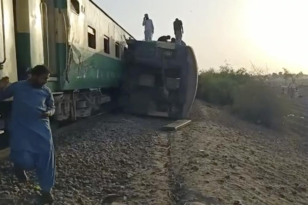 This image from a video, shows the site of a train collision in Ghotki, Pakistan Monday, June 7, 2021. Two express trains collided in southern Pakistan early Monday, killing dozens of passengers, authorities said, as rescuers and villagers worked to pull injured people and more bodies from the wreckage. (AP Photo)