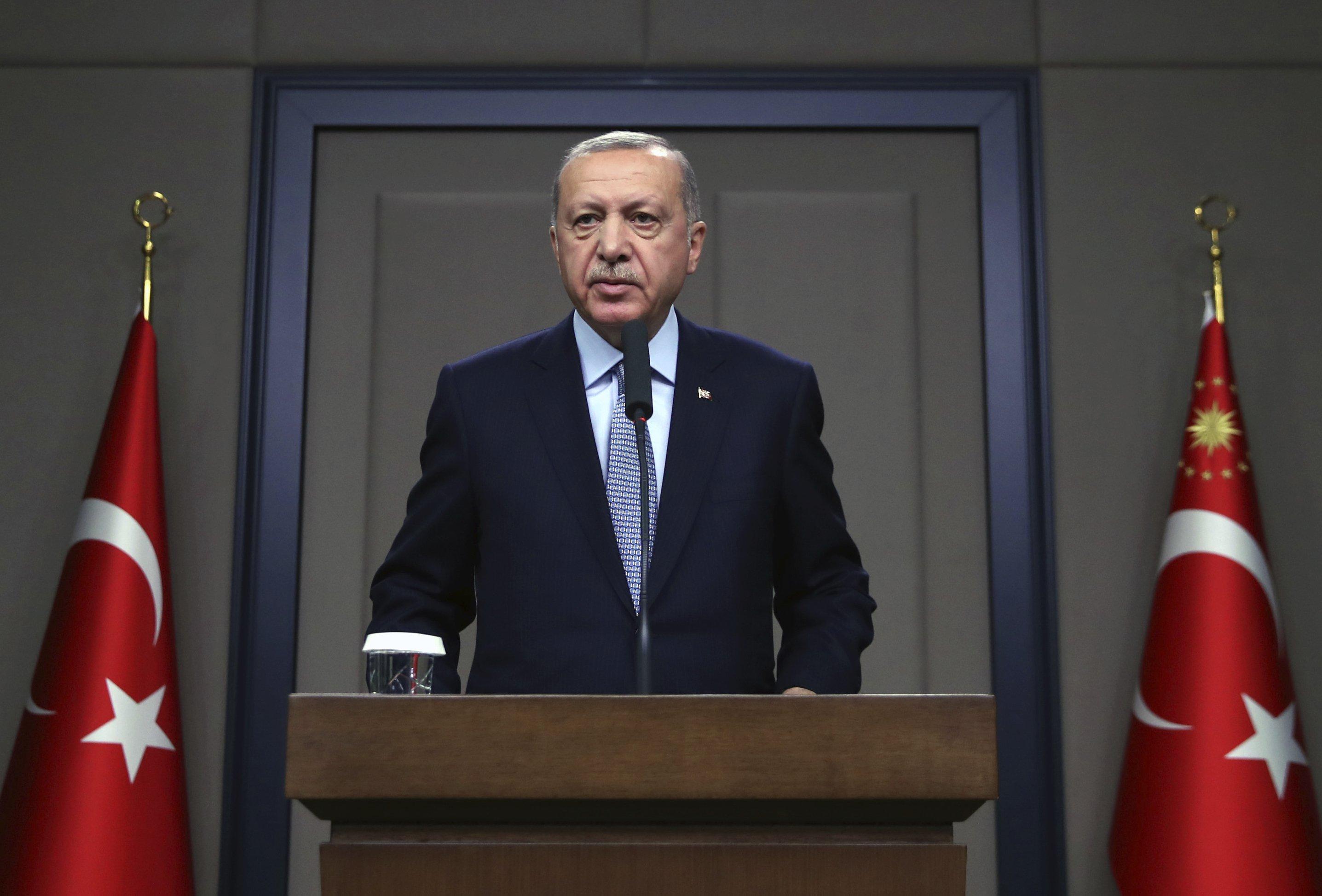 Erdogan warns Kurdish fighters to pull out of Syrian region
