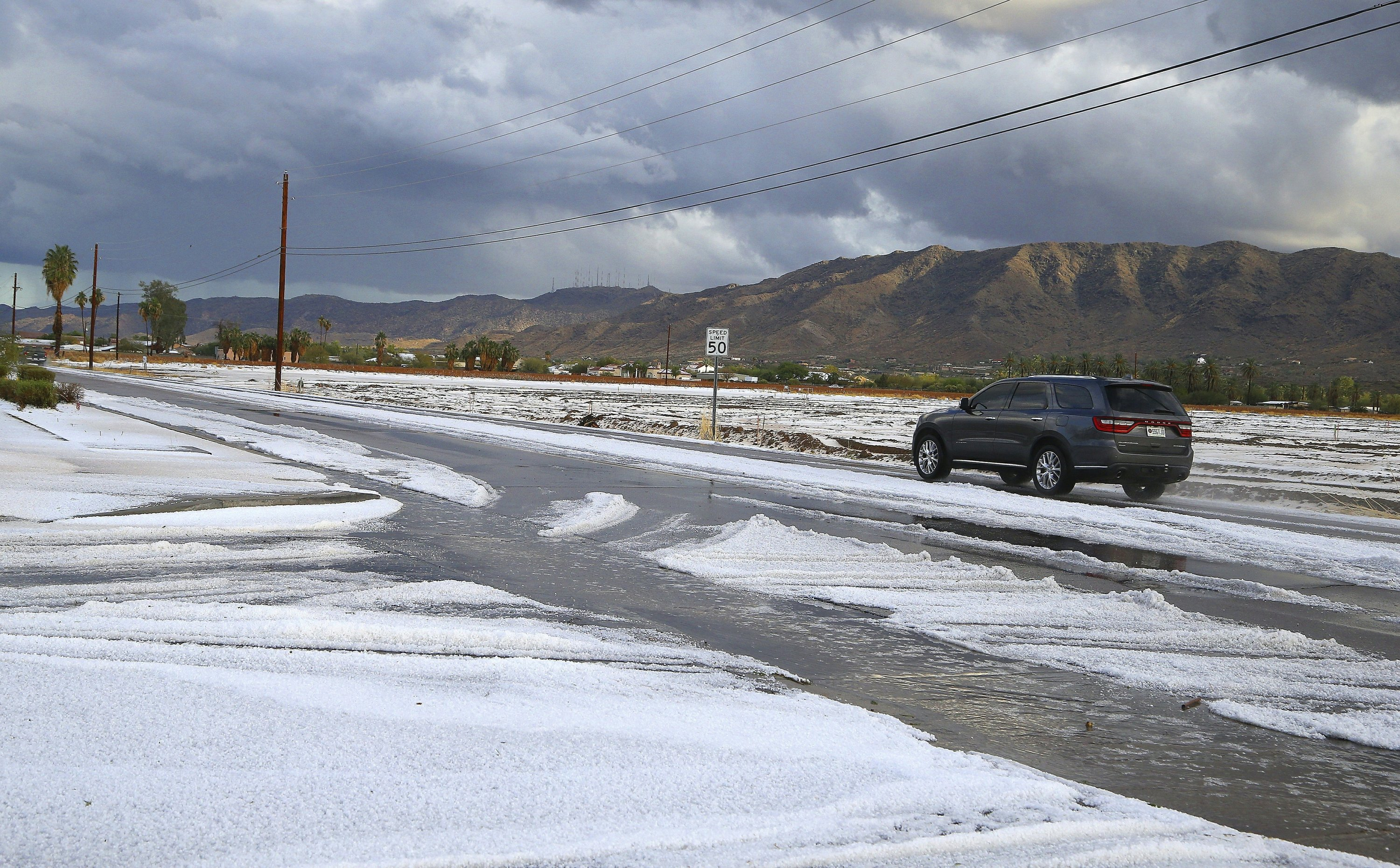 Snow-like hail in Phoenix-area desert caps days of storms