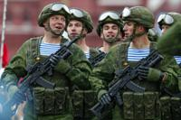 FILE - In this May 9, 2021, file photo, Russian paratroopers march the Victory Day military parade in Red Square in Moscow, Russia, marking the 76th anniversary of the end of World War II in Europe. Earlier this year, Russia bolstered its forces near Ukraine and warned Kyiv that it could intervene militarily if Ukrainian authorities try to retake the rebel-controlled east. Moscow also has bristled at NATO's joint drills with Ukraine, saying they reflect the alliance's aggressive intentions. (AP Photo/Alexander Zemlianichenko, File)