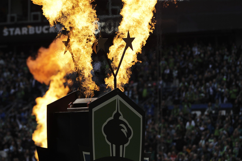 Defending champion Sounders beat Fire 2-1 in opener