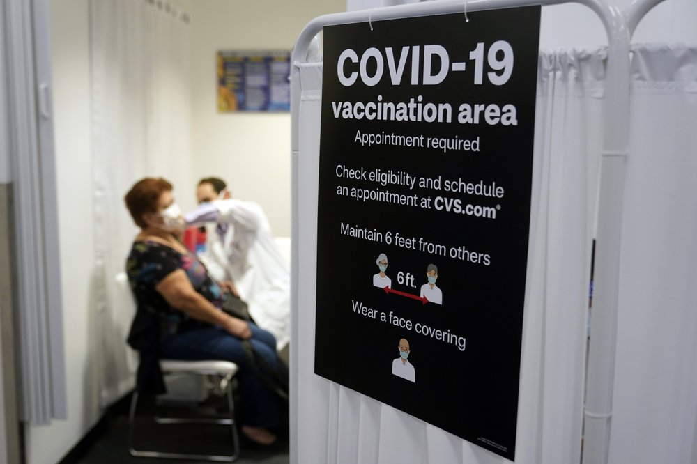 Americans vaccinated against COVID-19 wait for guidance from health officials