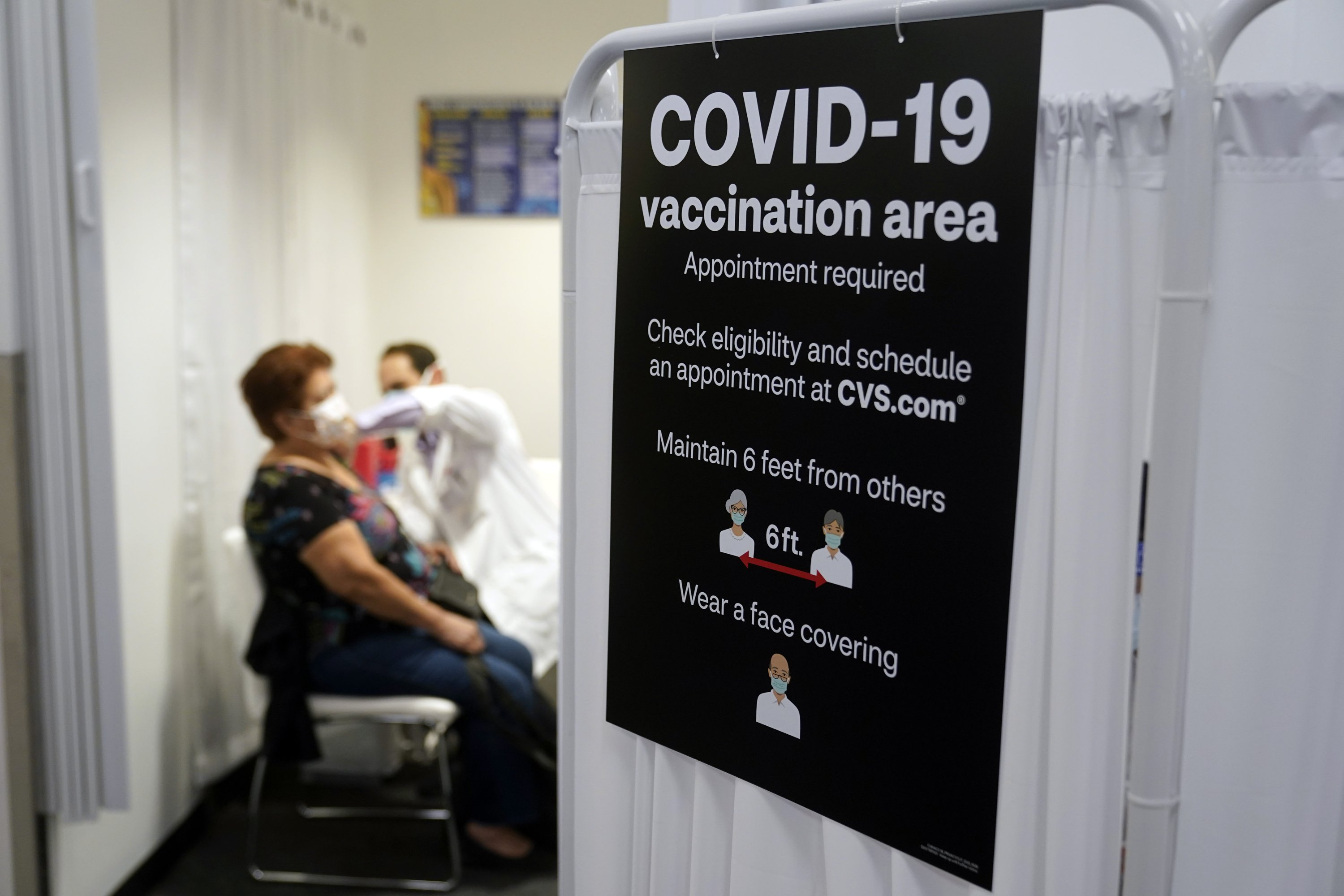 Americans vaccinated against COVID-19 still wait for advice – The Associated Press