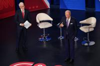 President Joe Biden participates in a CNN town hall at the Baltimore Center Stage Pearlstone Theater, Thursday, Oct. 21, 2021, in Baltimore, with moderator Anderson Cooper. (AP Photo/Evan Vucci)