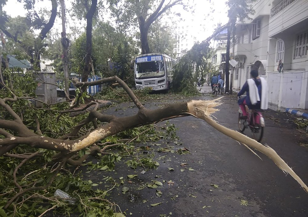 At least 24 people reported killed as powerful cyclone ripped through densely populated coastal India and Bangladesh