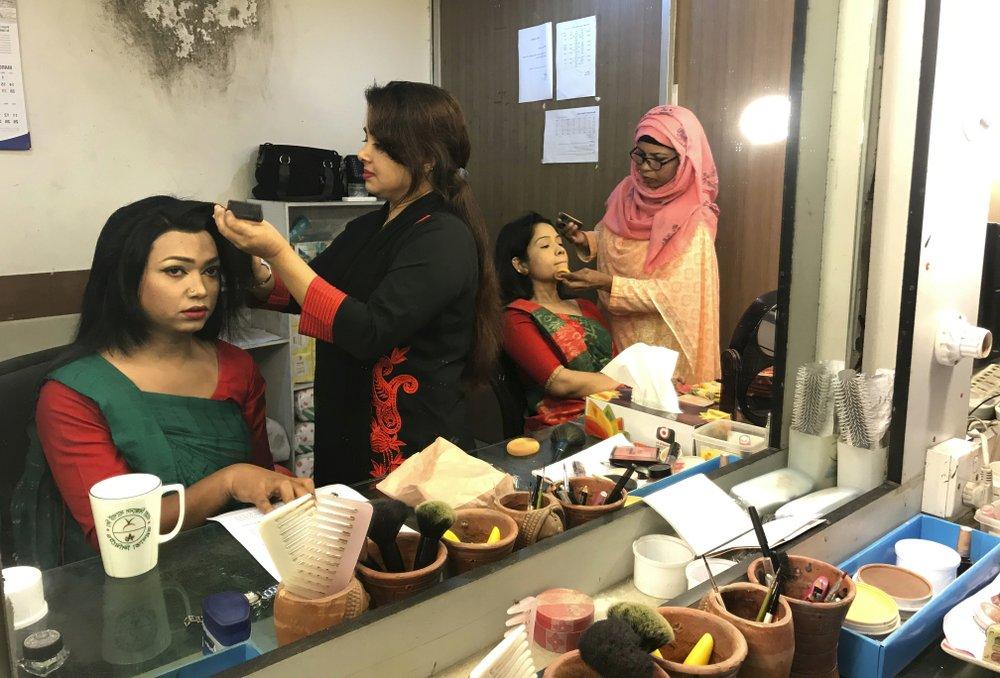 Bangladesh's first transgender news anchor Tashnuva Anan Shishir, left, gets ready to read news bulletin, in Dhaka, Bangladesh, Tuesday, March 9, 2021.