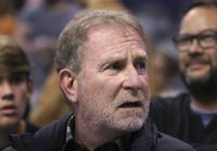 """FILE - In this Dec. 11, 2019, file photo, Phoenix Suns owner Robert Sarver watches the team play against the Memphis Grizzlies during the second half of an NBA basketball game in Phoenix. The Suns released a statement regarding a potential media investigation into the workplace culture of the franchise, denying that the organization or Sarver has a history of racism or sexism. The statement sent Friday, Oct. 22, 2021, said the organization is aware that ESPN is working on a story accusing the organization of misconduct on a """"variety of topics."""" The Suns responded by saying they were """"completely baseless claims"""" and """"documentary evidence in our possession and eyewitness accounts directly contradict the reporter's accusations, and we are preparing our response to his questions."""" (AP Photo/Ross D. Franklin, File)"""