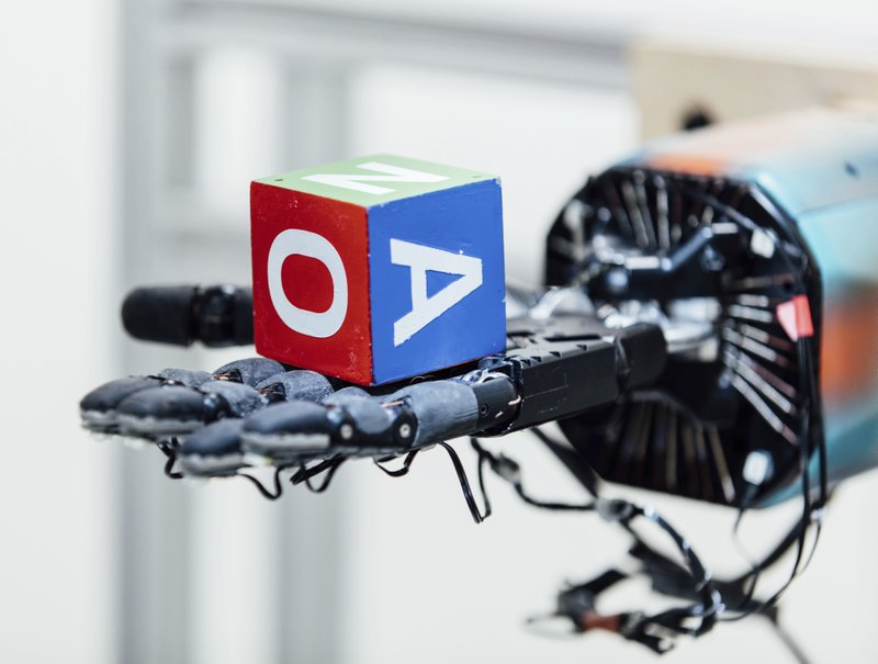 A robotic hand can juggle a cube _ with lots of training