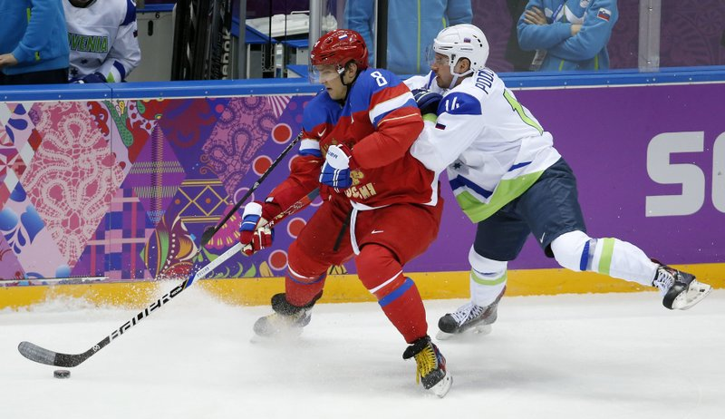 48ffcc341 13, 2014, file photo, Russia forward Alex Ovechkin, left, keeps the puck  from Sovenia defenseman Matic Podlipnik during a men's ice hockey game at  the ...