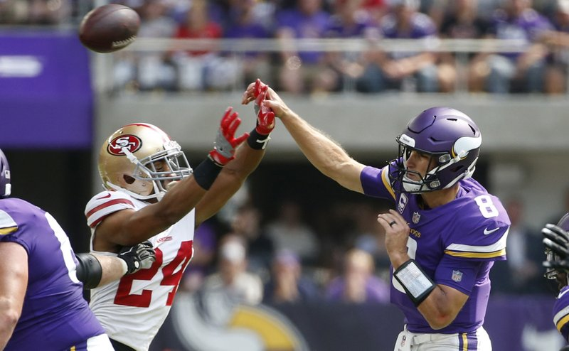 Minnesota Vikings quarterback Kirk Cousins (8) throws a pass over San  Francisco 49ers defensive back K Waun Williams (24) during the first half of  an NFL ... d3e50d6a0