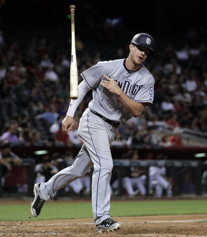 San Diego Padres' Wil Myers tosses hit bat after hitting a three run home run against the Arizona Diamondbacks during the seventh inning of a baseball game, Monday, April 24, 2017, in Phoenix. (AP Photo/Matt York)