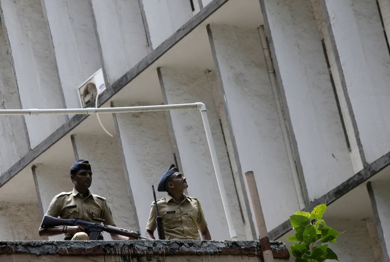 Indian police officials stand guard outside the sessions court complex in Mumbai, India, Thursday, Sept. 7, 2017. An Indian court has sentenced two men to death and another two to life in prison for a series of bombings that killed 257 in Mumbai in 1993. The four Indian men had earlier been convicted of criminal conspiracy and murder in the planting of 12 powerful bombs in cars, scooters and suitcases around India's financial capital.