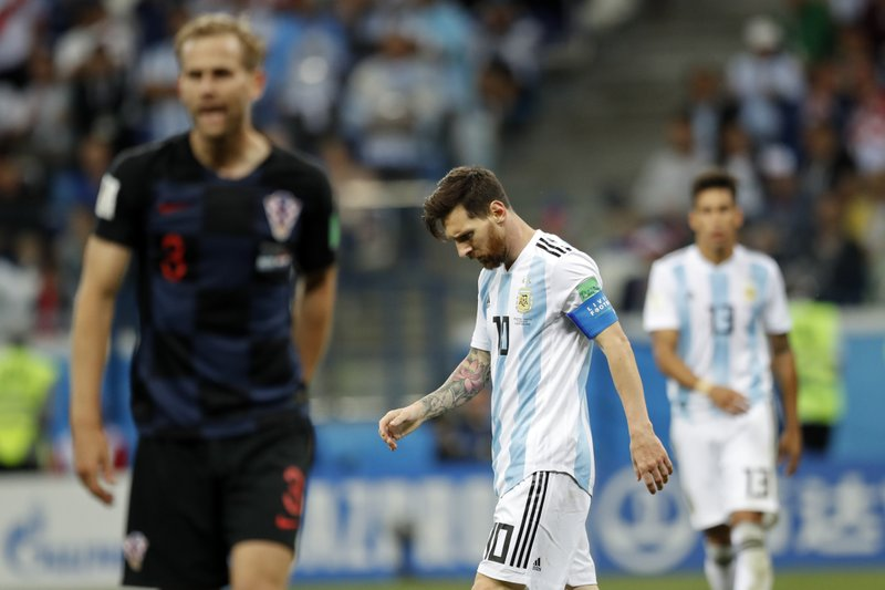 Argentina's Lionel Messi, center looks down after Croatia's Luka Modric scored his side's second goal during the group D match between Argentina and Croatia at the 2018 soccer World Cup in Nizhny Novgorod Stadium in Novgorod, Russia, Thursday, June 21, 2018.
