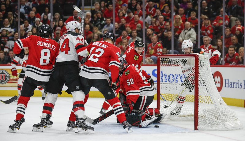 Miles Wood, Corey Crawford