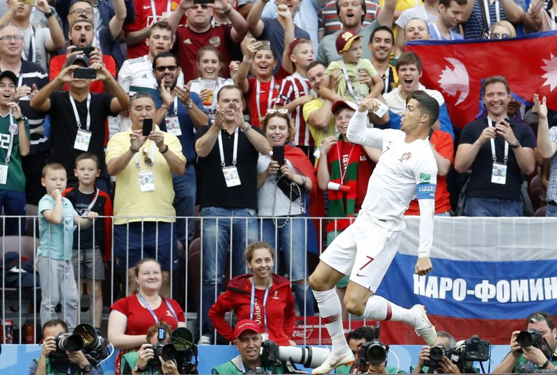 Portugal's Cristiano Ronaldo celebrates after scoring his side's opening goal during the group B match between Portugal and Morocco at the 2018 soccer World Cup at the Luzhniki Stadium in Moscow, Russia, Wednesday, June 20, 2018.