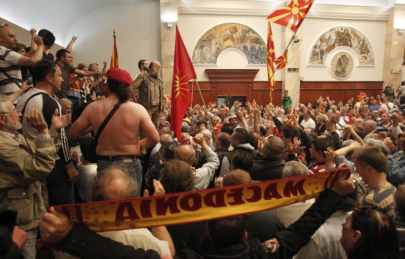 Protestors enter the parliament building in Skopje, Macedonia, Thursday, April 27, 2017. Scores broke through a police cordon to protest the election of a new speaker despite a months-long deadlock in talks to form a new government. Political tensions have been building in Macedonia for the past two years, and the country has been under a caretaker government since inconclusive early December elections.