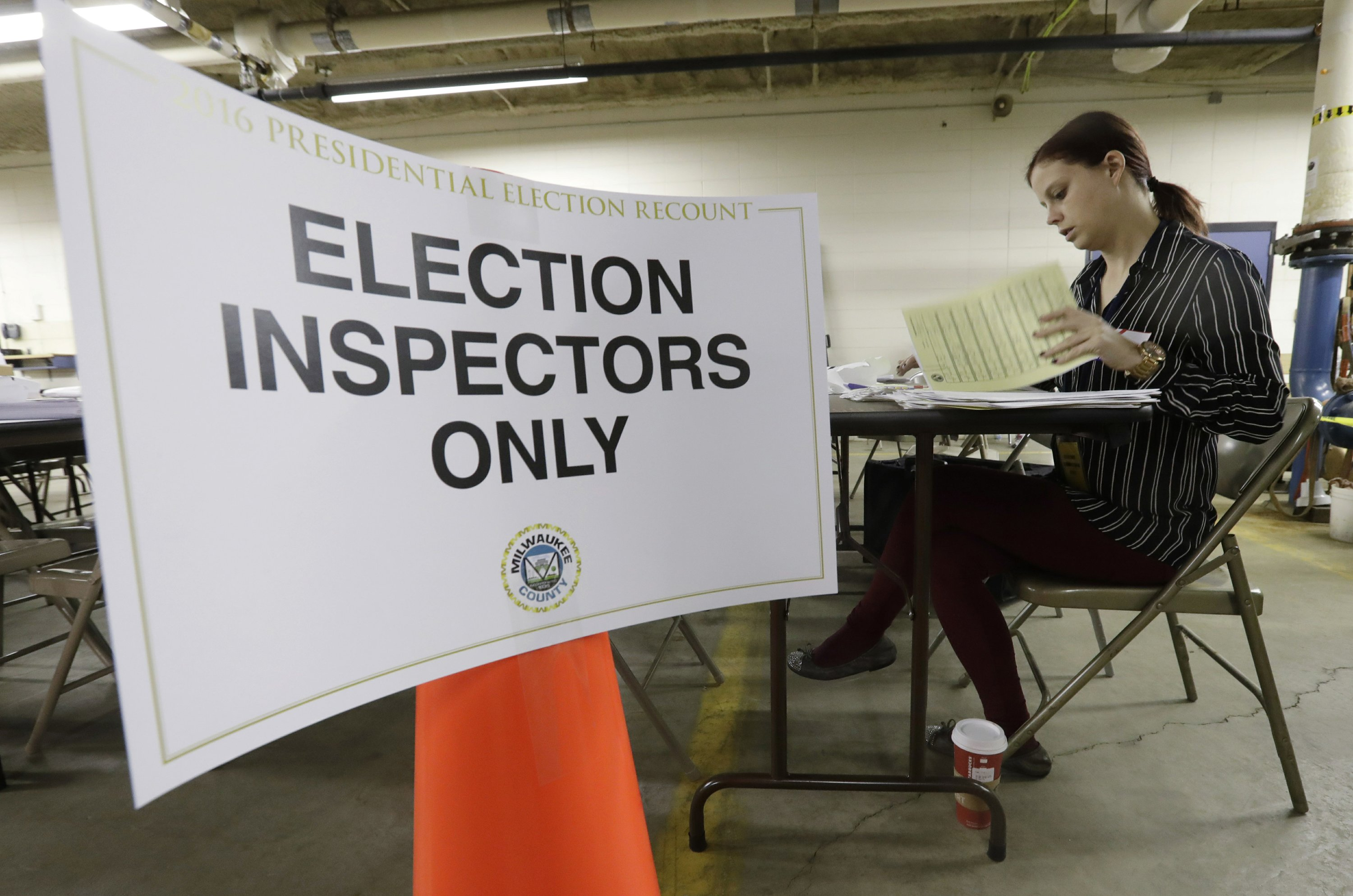 Wisconsin election recount begins; Michigan's is challenged