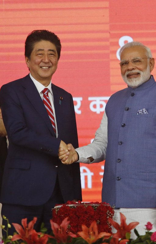 Japanese Prime Minister Shinzo Abe, left and Indian Prime Minister Narendra Modi shake hands during the ground breaking ceremony for high speed rail project in Ahmadabad, India, Thursday, Sept. 14, 2017.