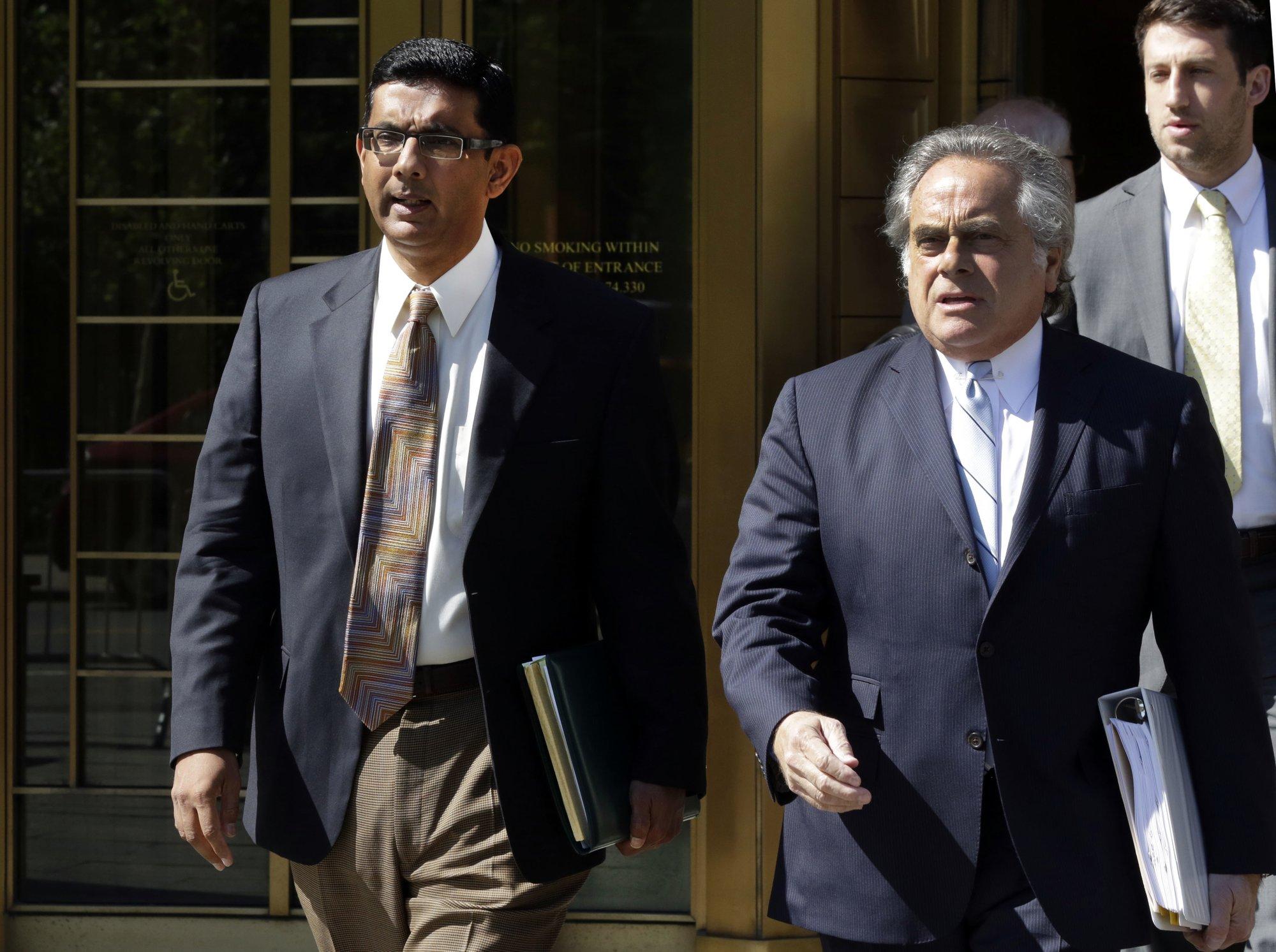 The Latest: Trump pardons conservative commentator D'Souza