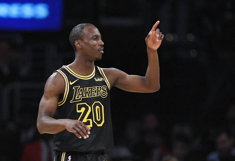 891e7a8263c Los Angeles Lakers forward Channing Frye gestures after scoring during the  first half of the team s NBA basketball game against the Houston Rockets on  ...