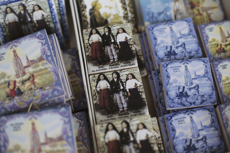 In this photo taken May 4, 2017, souvenir tiles are displayed for sale at a shop in the village of Aljustrel, outside Fatima, Portugal. The tiles show Lucia Santos, Francisco Marto and Jacinta Marto, the Portuguese shepherd children who say they saw visions of the Virgin Mary 100 years ago. Pope Francis is visiting the Fatima shrine on May 12 and 13 to canonize Francisco and Jacinta Marto.
