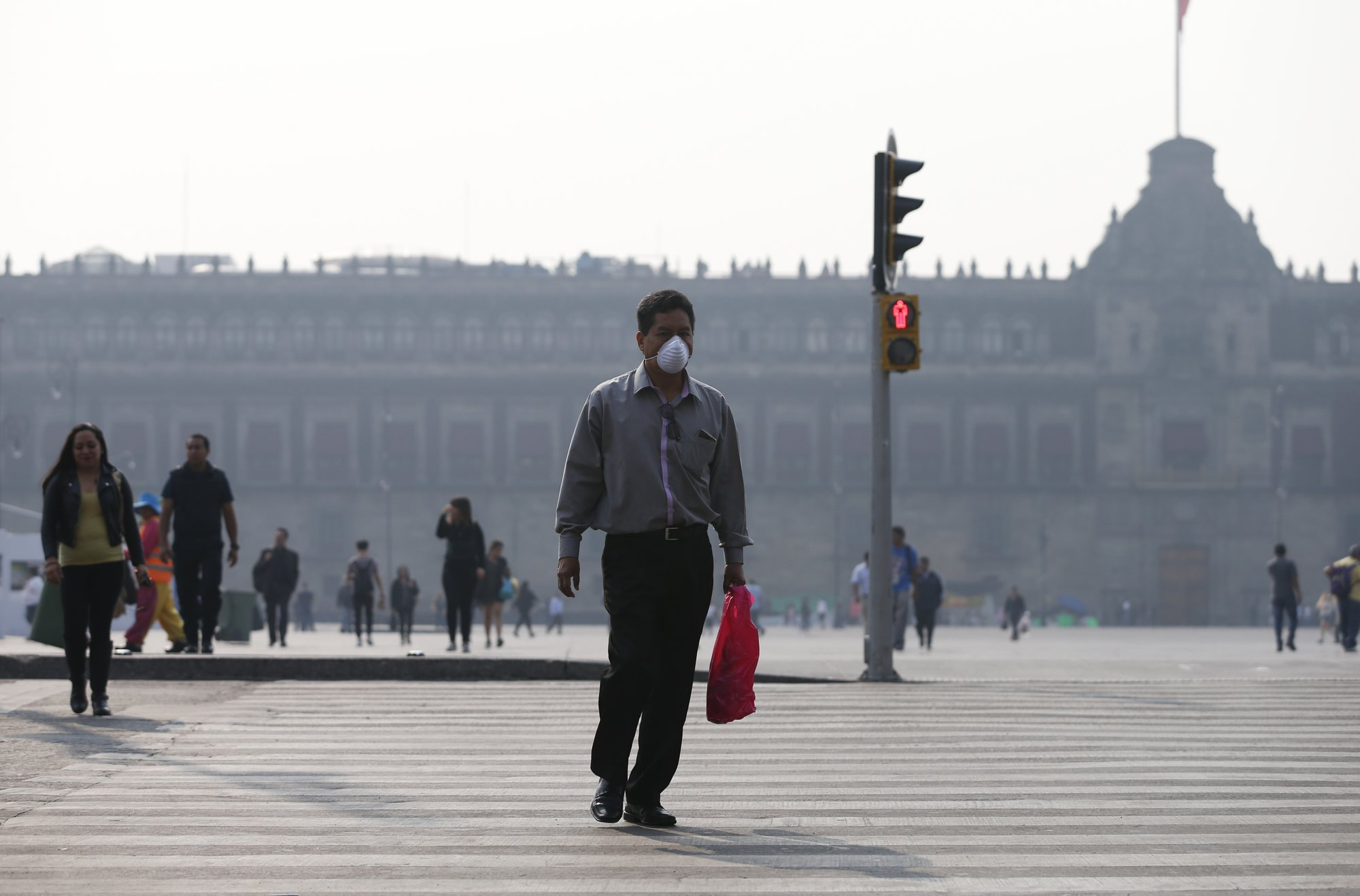 Mexico City closes schools, restricts traffic due to smoke