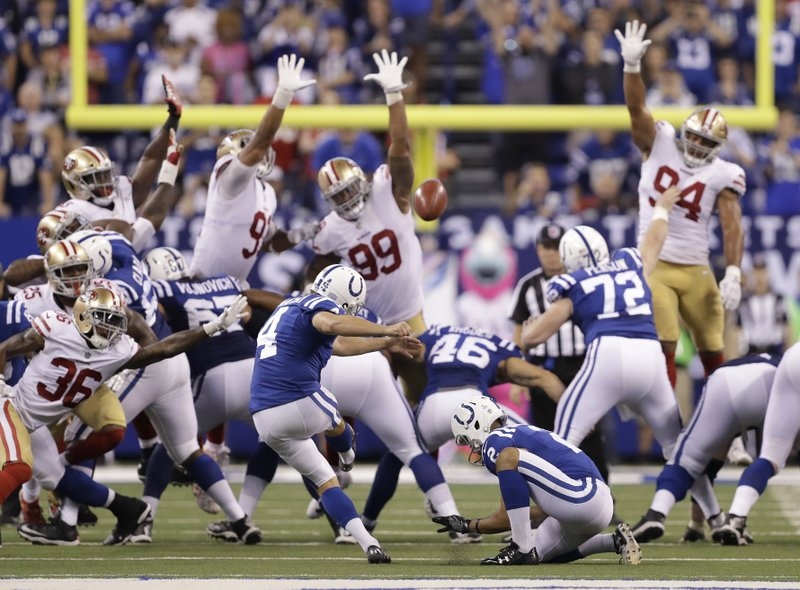 sports shoes e3103 886d6 Indianapolis Colts  Adam Vinatieri (4) kicks a game winning 51-yard field  goal out of the hold of Rigoberto Sanchez (2) during overtime of an NFL  football ...