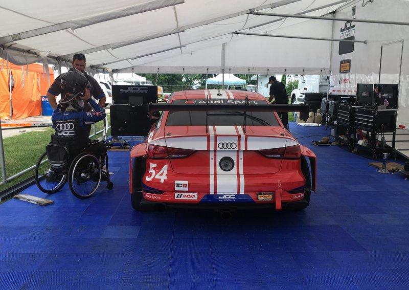 Paraplegic race car driver scores 1st pro win, seeks more